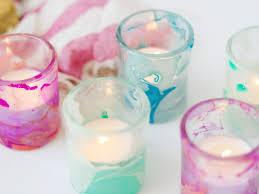 use nail polish to create marbled votives hgtv