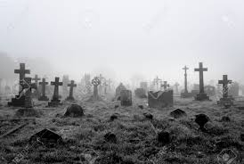 antique halloween background spooky foggy ancient cemetery halloween background stock photo