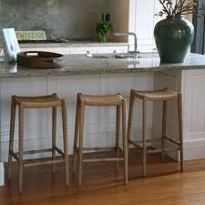 furniture seagrass saddle bar stools for appealing kitchen square white leather saddle bar stools with white cabinets and countertop for kitchen decoration ideas