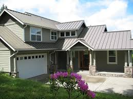 grey metal roof with green painted house looks nice together
