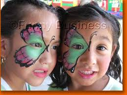Photo of two girls with butterfly face paint designs