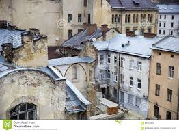 top view of the cracked walls and tin roofs of the old town hous