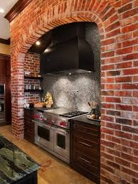 kitchen earthy kitchen with exposed brick wall and mosaic