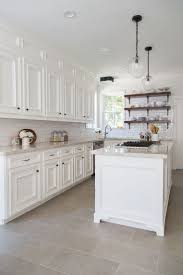 best 25 tile floor kitchen ideas on pinterest tile floor before after a dark dismal kitchen is made light and bright