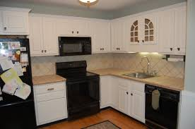 image of decor refacing kitchen cabinets image lovable kitchen lovable kitchen cabinet refacing in white plus black oven and black frige plus sink plus lovely