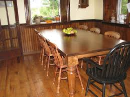 varnished hardwood long dining table and chairs mixed black solid