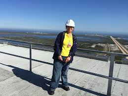 Donna Cendana stands on top of the Vehicle Assembly Building