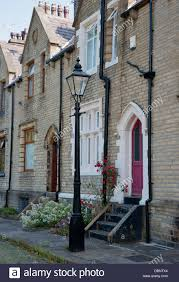 neo gothic victorian terraced houses and gaslamp stock photo