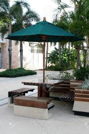 Outdoor Seating by Table Chairs And Umbrella Outdoor Seating Area Stock Photo