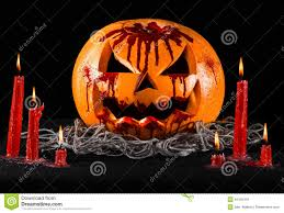 bloody pumpkin jack lantern pumpkin halloween red candles on a