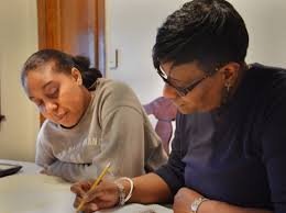 Second Chance Diploma  Examining the GED   American RadioWorks Jean Griggs at home with Jalisa Parker  her son     s girlfriend  Parker is helping Griggs with her Academy of Hope math homework  March