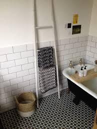 family bathroom metro white gloss wall tiles brick bond ladder