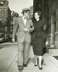 s couple walking down street date suit dress
