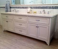 turquoise tile backsplash bathroom transitional with double sinks