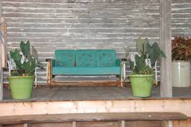 our life on the hill vintage metal glider bench