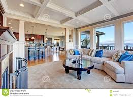 luxury house with open floor plan coffered ceiling carpet and