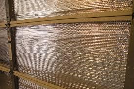 how to insulate a garage door diy garage insulation houselogic
