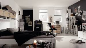 Gray Floors What Color Walls by Black Bed With Wall And Gray Floor Also Glass Windows White Table