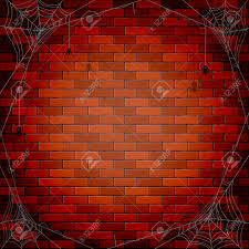 halloween background with spiders and spiderweb on a brick wall