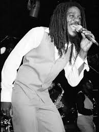 Dennis Brown onstage. i i