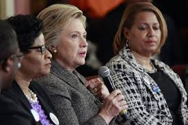 Hillary Clinton  with microphone  brought her presidential campaign to Milwaukee on March          and attended a forum on gun violence  PolitiFact
