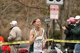 Lori Kingsley Races Up With Face Of Pain Stock Photo - Image: 9050870 - 1240262744QQoJ3b