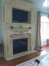 custom distressed white fireplace surround marble inlay around