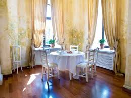 round dining room table and chairs using floral curtain designs
