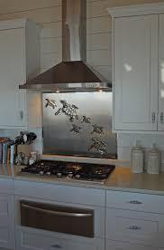stainless steel backsplash with sea turtles r mended metals llc