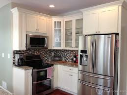 Complete Kitchen Cabinets Cute White Shaker Kitchen With An Island With Barstool Seating