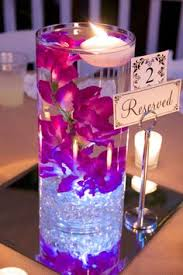 Purple Floating Candles For Centerpieces by Flower Submerged In Water Centerpiece Google Search Wedding