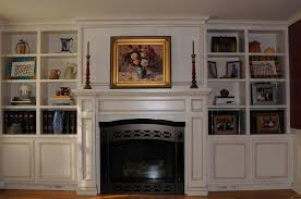 shelving next to fireplace find this pin and more on fireplace