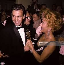 joan crawford and maximilian schell holding oscar pictures getty