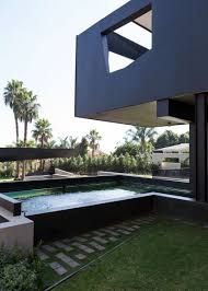 100 pool houses to be proud of and inspired by modern sspacious home with pool in black