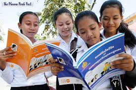 Students browse through new sex education reading material at Wat Phnom High School in Phnom Penh last week  HONG MENEA