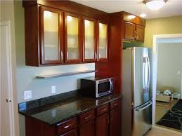 Cherry Cabinets And Backlit Frosted Glass Doors Reinke - Kitchen cabinet with glass doors