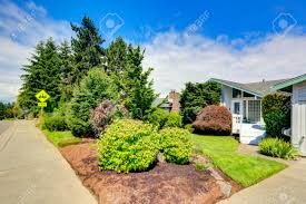 house exterior with curb appeal view of front yard landscape