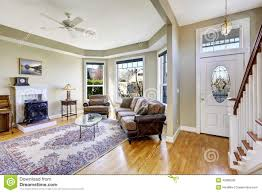 house interior with open floor plan living room and entrance ha