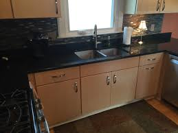 we installed natural quartersawn maple cabinets with uba tuba