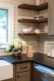 black and white backsplash kitchen with black granite counter and