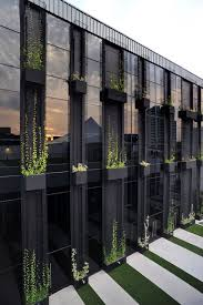 Troughs With Climbers On Facade Of Building Green Walls Green - Landscape wall design