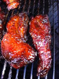 amazing slow smoked country style ribs coated in a peach preserve