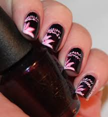 more floral nail art light flowers on a dark base set in lacquer