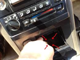 nissan altima 2005 door panel removal how to replace center console cup holder in nissan maxima 00 01 02