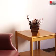 wooden magazine holder made in italy vitruvio design