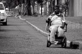PHOTOGRAPHING DISABILITY    aka Street Encounters with Persons