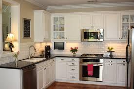 white kitchen cabinets dark granite countertops outofhome
