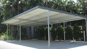moder large metal carport on the side of the house that has black