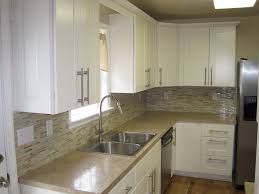 Remodeled Kitchens With White Cabinets by Tan Beige Laminate Counters W Matching Mosaic Backsplash Kitchen