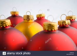 closeup of one gold christmas tree bulb ornament stands out among